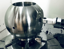 A 90 degree angle head entering a spherical workpiece.