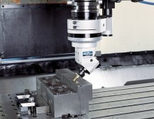 Angle head milling a workpiece.